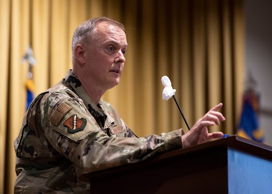Col. John Creel, 39th Air Base Wing commander, speaks from a stage podium to Airmen in-person and online during a commander's call at Incirlik Air Base, Turkey, Aug. 25, 2020