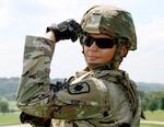 CPT April Bruner flexing in uniform.