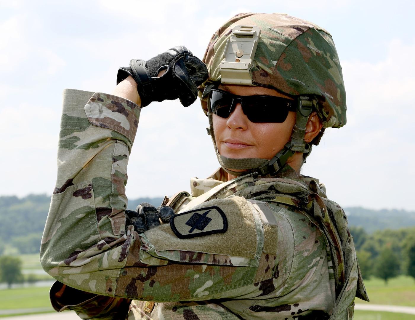 CPT Bruner flexing in uniform.