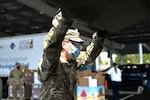 Pfc. Logan O'Malley, 3643d Brigade Support Battalion, NHARNG, loads a car with food on Aug. 7, 2020, at a mobile pantry drive-thru in Manchester.