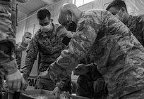Seasoned Soldiers and Airmen with Task Force Distribution explain the process of packaging and distributing PPE to newly activated N.H. guardsmen at the TF Distro warehouse Aug. 25, 2020, in Concord.