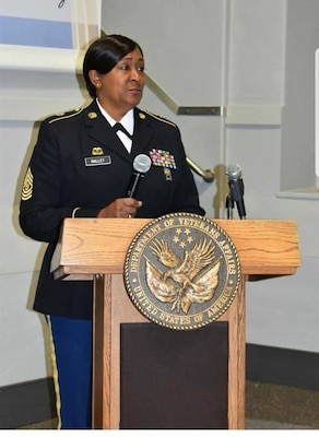 Sgt. Maj. Debora Mallet from the 42nd Infantry Division, who is the noncommissioned officer in charge for supply and services under the division's logistics section, speaks at a public event.