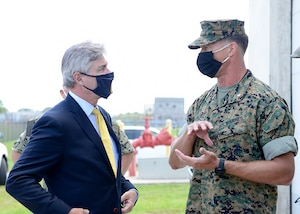 Secretary of the Navy Kenneth J. Braithwaite is greeted by Lt. Col. Michael Weber, commanding officer of Marine Corps Security Force Battalion, prior to his tour during his visit to the Waterfront Security Force Facility at Naval Submarine Base Kings Bay, Ga.
