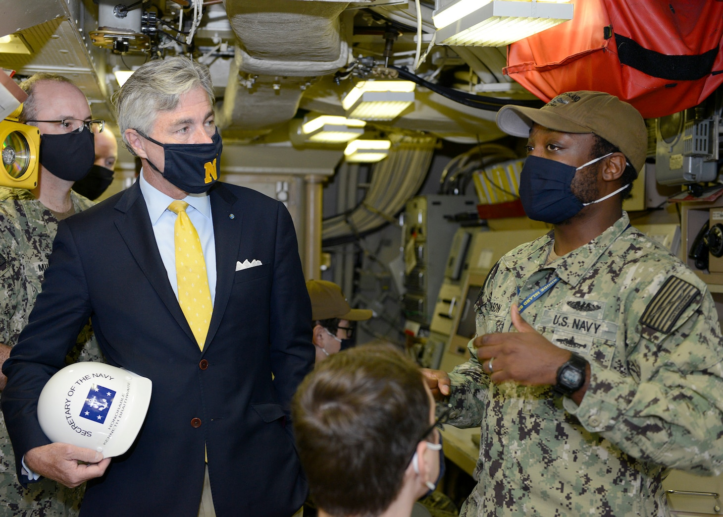 Secretary of the Navy Kenneth J. Braithwaite talks with Missile Technician 1st Class Tremayne Johnson, aboard the Ohio-class ballistic-missile submarine USS Rhode Island (SSBN 740) (Blue) in the ship's missile control center during his visit to Naval Submarine Base Kings Bay, Ga.