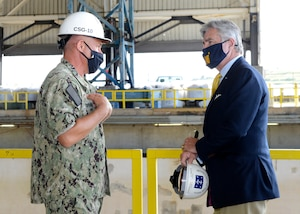 Secretary of the Navy Kenneth J. Braithwaite tours the largest covered dry dock in the U.S. with Rear Adm. John Spencer, commander of Submarine Group Ten, during his visit to Naval Submarine Base Kings Bay, Ga.