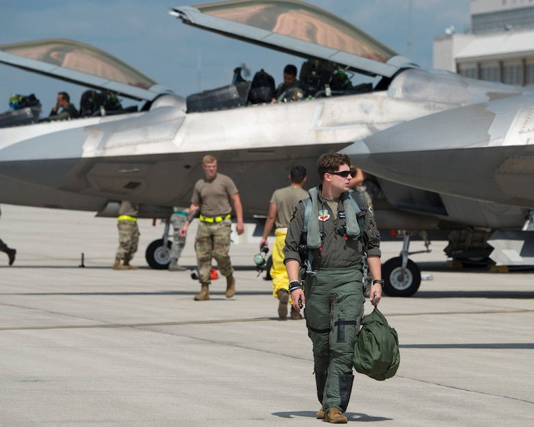 An U.S. Air Force F-22 Raptor pilot walks away from his aircraft shortly after his arrival at Wright-Patterson Air Force Base, Ohio, Aug 23, 2020. He was one of eight pilots with the 325th Fighter Squadron who flew their planes up from Eglin AFB, Fla., to protect them from Hurricane Marco and Tropical Storm Laura which are approaching the U.S. Gulf Coast. (U.S. Air Force photo by R.J. Oriez)