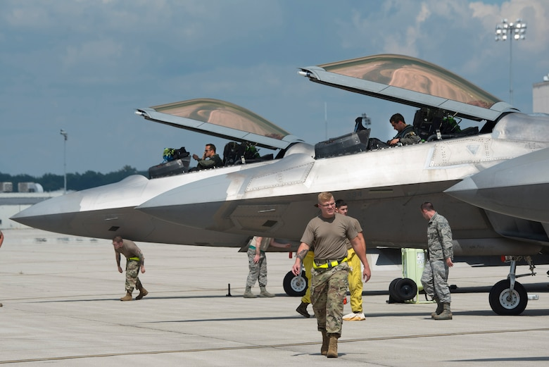 U.S. Air Force pilots and aircraft mechanics of the 425th Fighter Wing secure F-22 Raptor aircrafts shortly after their arrival at Wright-Patterson Air Force Base, Ohio. Eight aircraft of the 325th FW, out of Eglin Air Force Base, Fla., flew to Wright-Patterson AFB to evade Hurricane Marco and Tropical Storm Laura which are approaching the U.S. Gulf Coast. (U.S. Air Force photo by R.J. Oriez)