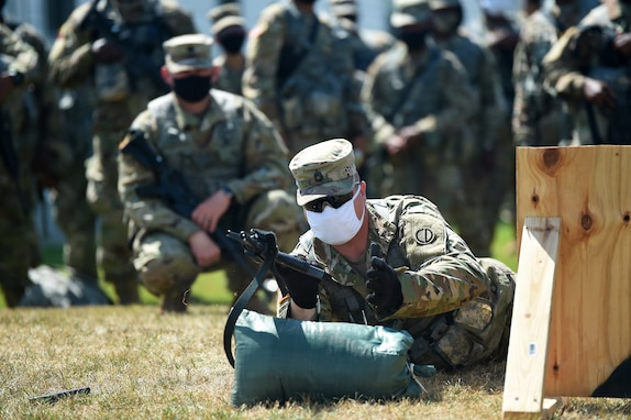 U.S. Army Reserve Sgt. 1st Class Eric Monson, observer coach/trainer assigned to the 1st Battalion, 383rd Regiment in Des Moines, Iowa, conducts a demonstration during Table 3 of the new Army Individual Weapons Qualification standards that will take effect on October 1, 2020.