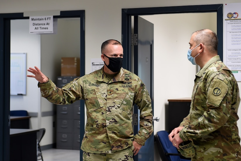 Brig. Gen. Walter Duzzny, left, commanding general of the 78th Training Division, meets with Brig. Gen. Ernest Litynski, commanding general of the 85th U.S. Army Reserve Support Command, during Operation Ready Warrior exercise, at Fort McCoy, Wisconsin, August 22, 2020.