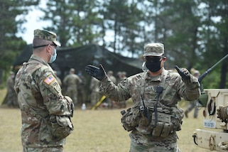 Brig. Gen. Ernest Litynski, left, commanding general of the 85th U.S. Army Reserve Support Command, meets with Chief Warrant Officer 3 Richard Begonia, an active component observer coach/trainer, assigned to 1st Battalion, 351st Regiment (Brigade Support Battalion), during Operation Ready Warrior exercise, at Fort McCoy, Wisconsin, August 22, 2020.