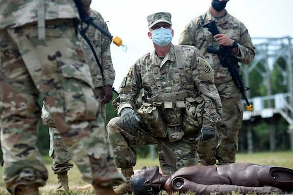 Army Reserve Sgt. 1st Class Andrew Banta, 1st Battalion, 338rd Regiment, gives instruction on Evaluating a Casualty to Soldiers from the 623rd Inland Cargo Transfer Company, during Operation Ready Warrior exercise, at Fort McCoy, Wisconsin, August 22, 2020.