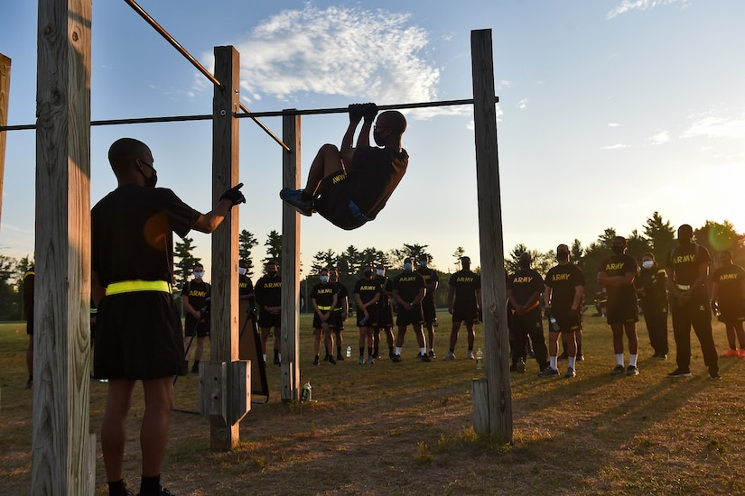 Army Reserve observer coach/trainers, assigned to the 85th U.S. Army Reserve Support Command, working under First Army's 181st Multi-functional Training Brigade, demonstrate the proper way to conduct the leg tuck, one of six test events for the Army Combat Fitness Test, during Operation Ready Warrior exercise, at Fort McCoy, Wisconsin, August 23, 2020.