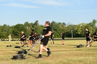 Army Reserve Soldiers pull a 90-pound sled during the Sprint-Drag-Carry event, one of six test events for the Army Combat Fitness Test, at Operation Ready Warrior exercise, at Fort McCoy, Wisconsin, August 23, 2020.