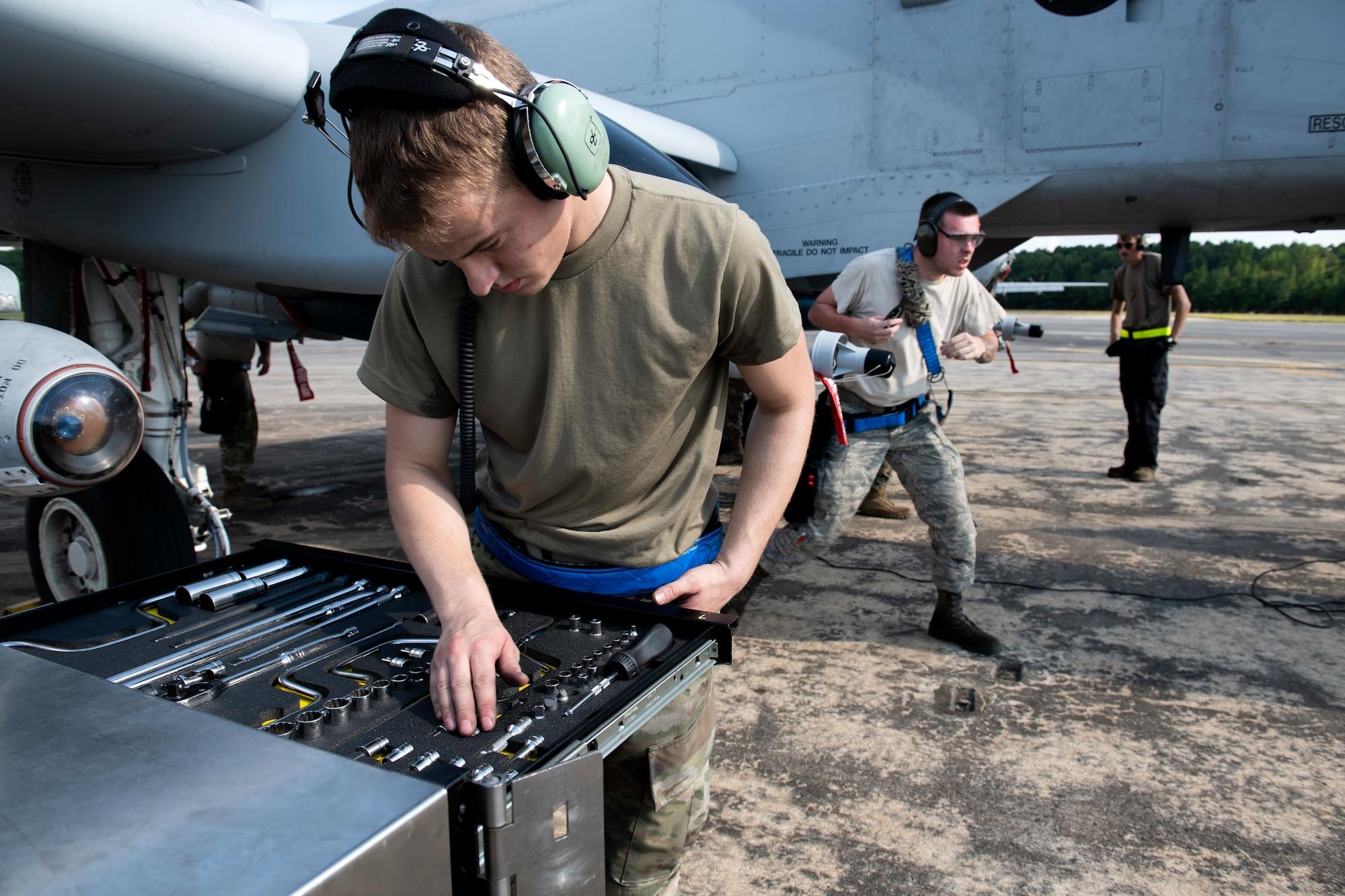 An Airman examines his tools
