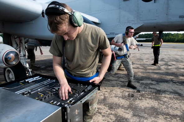 An Airman examines his tools