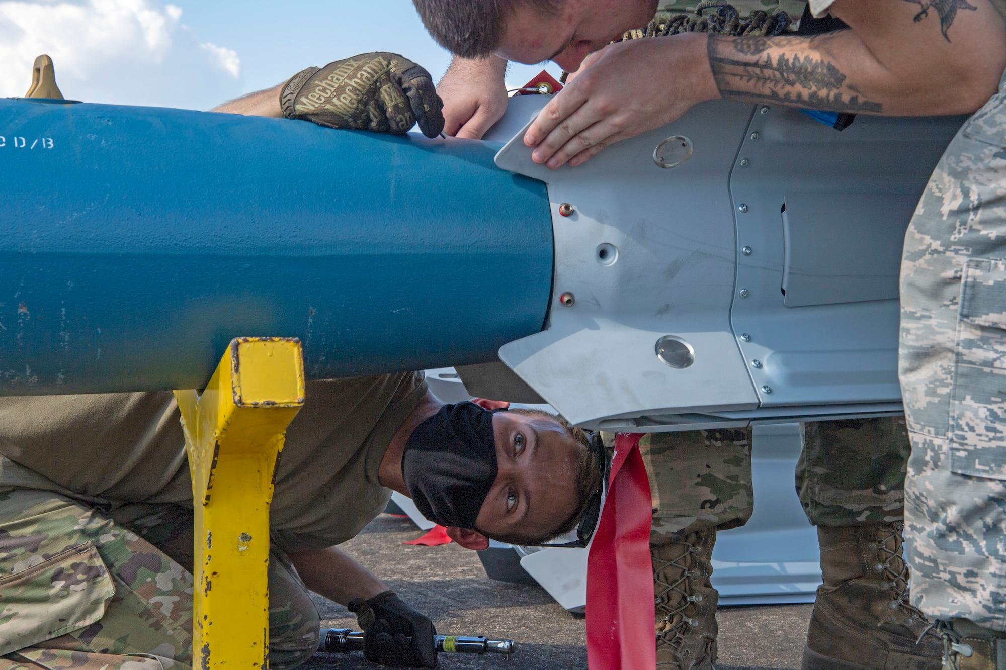 Airmen put together an inert munition