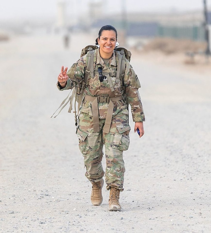 Capt. Jennifer Alvarez, company commander for the 42nd Infantry Division's Operation's Comany, does a 26.2 mile ruck march on her deployment to the Middle East March 18, 2020.