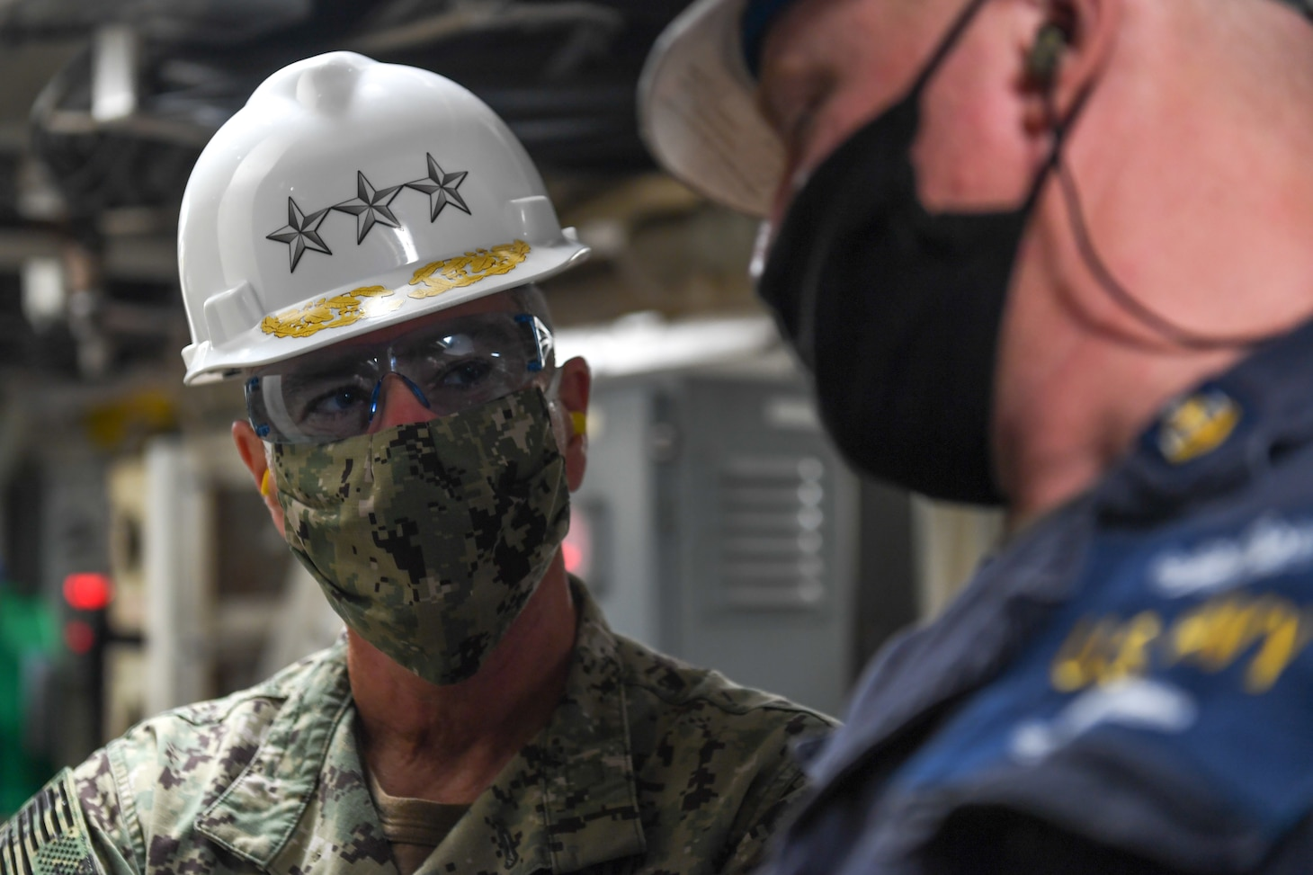 Vice Adm. Roy Kitchener, Commander, Naval Surface Force U.S. Pacific Fleet, tours the engine spaces of the dock landing ship USS Rushmore (LSD 47), with Senior Chief Engineman Jason Saffa.