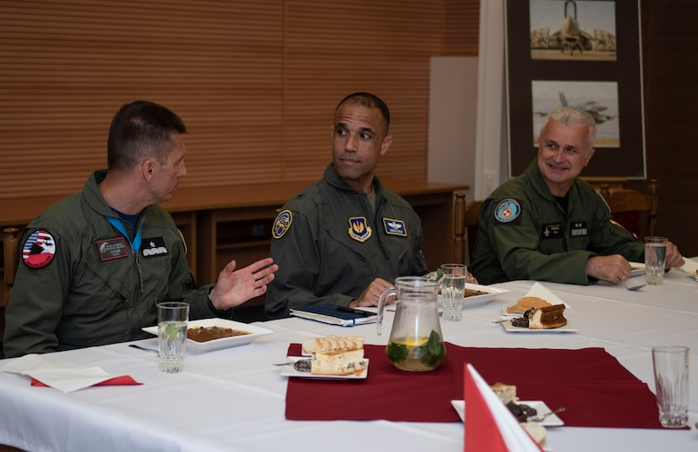 Starting far left, Polish air force Brig. Gen. Iteneusz Nowak, 2nd Tactical Air Wing commander, U.S. Air Force Brig. Gen. Adrian Spain, United States Air Forces in Europe and Air Forces Africa director of plans, programs and analyses, and Polish air force Maj. Gen. Jacek Pszczoła, inspector of the Polish air force, sit down for a meal, August 24, 2020, at Łask AB, Poland. The U.S. rotational military presence in Poland contributes security in the region and immense training that cannot be done without this partnership. (U.S. Air Force photo by Senior Airman Melody W. Howley)