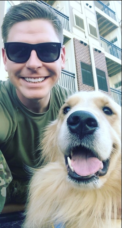 A man with sunglasses and a dog.