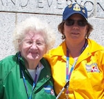 DIA Officer April Maletz (right) stands with WWII Navy veteran Alice Wamsley during an Old Dominion Honor Flight mission. Maletz is a 2020 recipient of the Spirit of Bob Hope Award for her work serving veterans.