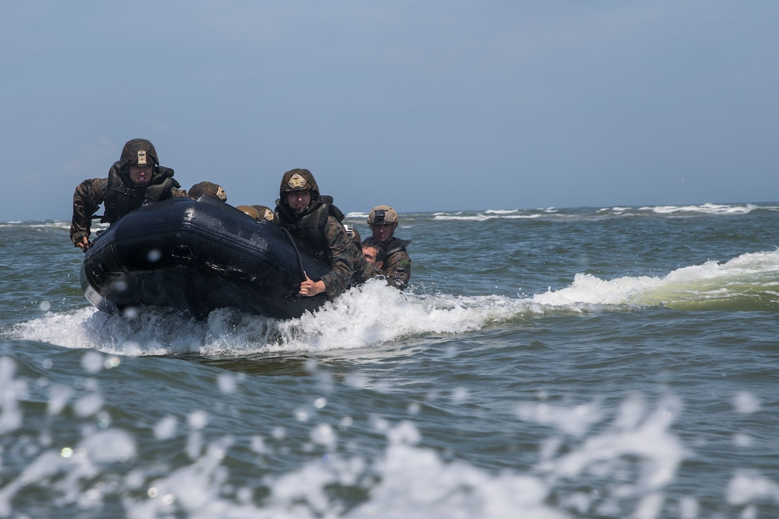 U.S. Marines with 2nd and 6th Air Naval Gun Fire Liaison Company and French Marines with 3rd Marine Artillery Regiment conduct Zodiac familiarization training as part of Burmese Chase at Camp Lejeune, N.C., May 18, 2019. Burmese Chase is an annual U.S. led multi-lateral exercise that includes training on fast-roping, naval gunfire and parachute employment with participating NATO allies. The exercise helps strengthen allied nations' security as well as enhances joint interoperability between NATO members. (U.S. Marine Corps photo by Cpl. Austin Livingston)