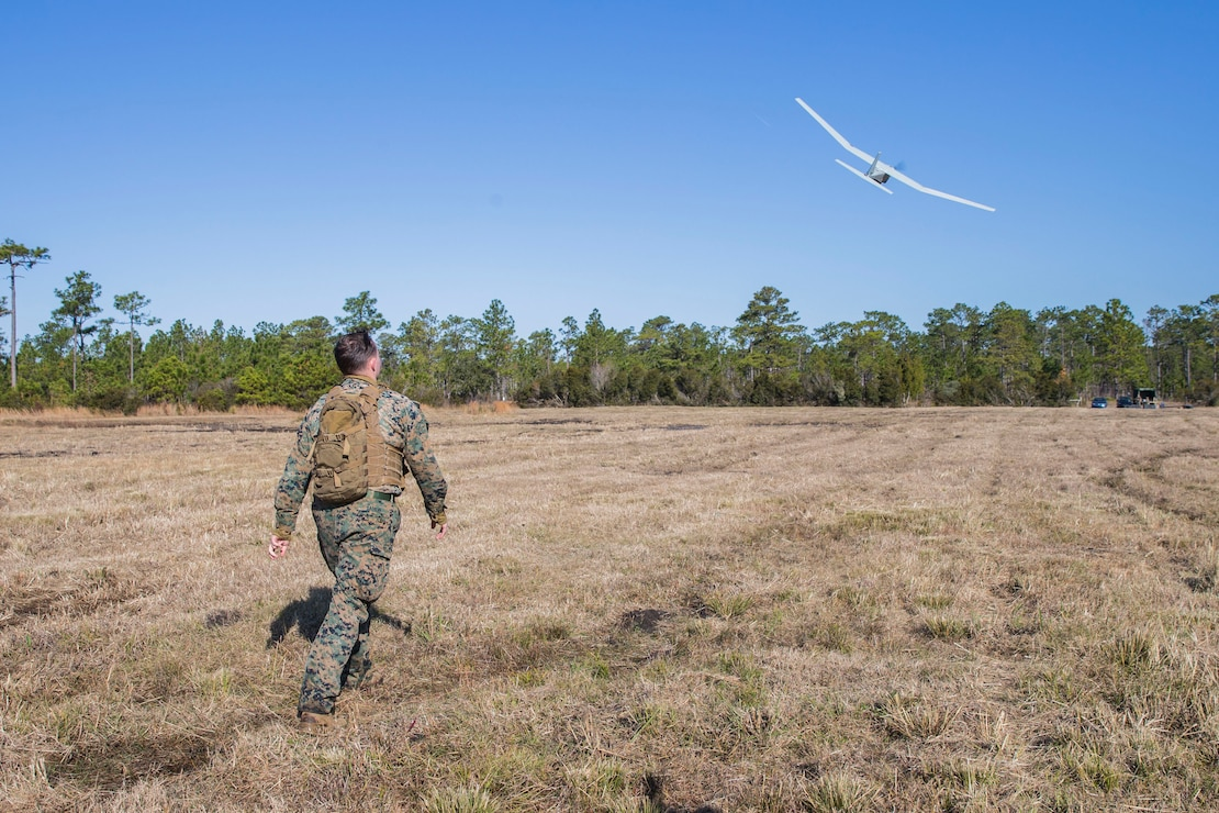 U.S. Marine Corps Cpl. Corey Dasilva, a fire support Marine with 2nd Air Naval Gunfire Liaison Company, II Marine Expeditionary Force Information Group, launches the RQ-20B PUMA Unmanned Aircraft System during a battalion exercise on Camp Lejeune, N.C., Dec. 12, 2019. The RQ-20B PUMA is a small hand-launched unmanned aircraft used for surveillance and intelligence gathering. (U.S. Marine Corps photo by Lance Cpl. Larisa Chavez)