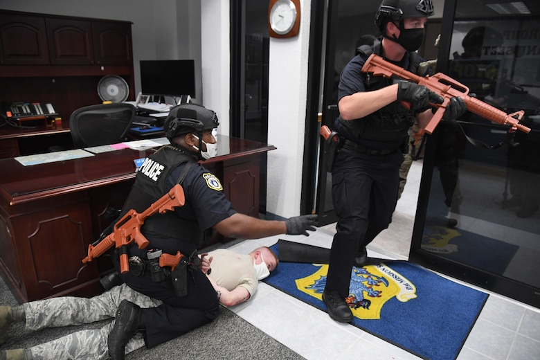 Sheenon Rhome, 81st Security Forces Squadron police officer, detains U.S. Air Force Staff Sgt. Blake Johnson, 81st SFS unit scheduler portraying an active shooter, as Tyler Sudduth, 81st SFS police officer, secures the room during an active shooter exercise inside the Sablich Center at Keesler Air Force Base, Mississippi, Aug. 20, 2020. The scenario included two active duty Air Force members who simulated opening fire inside the Sablich Center in order to test the base's ability to respond to and recover from a mass casualty event. (U.S. Air Force photo by Kemberly Groue)