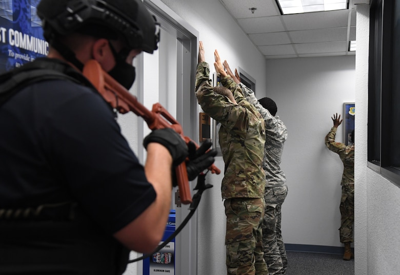Tyler Sudduth, 81st Security Forces Squadron police officer, secures the 81st Mission Support Group command section inside the Sablich Center during an active shooter exercise at Keesler Air Force Base, Mississippi, Aug. 20, 2020. The scenario included two active duty Air Force members who simulated opening fire inside the Sablich Center in order to test the base's ability to respond to and recover from a mass casualty event. (U.S. Air Force photo by Kemberly Groue)