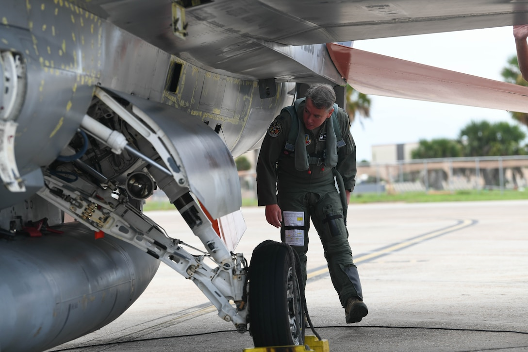 U.S. Air Force Col. Nicholas Reed with the 53rd Weapons Evaluation Group, commander, performs pre-flight checks of a QF-16 before takeoff at Tyndall Air Force Base, Florida, Aug. 21, 2020. The unit evacuated multiple aircraft to from the 325th Fighter Wing's airfield to Shaw Air Force Base, South Carolina, for safe haven from severe weather conditions. (U.S. Air Force photo by Airman Anabel Del Valle)