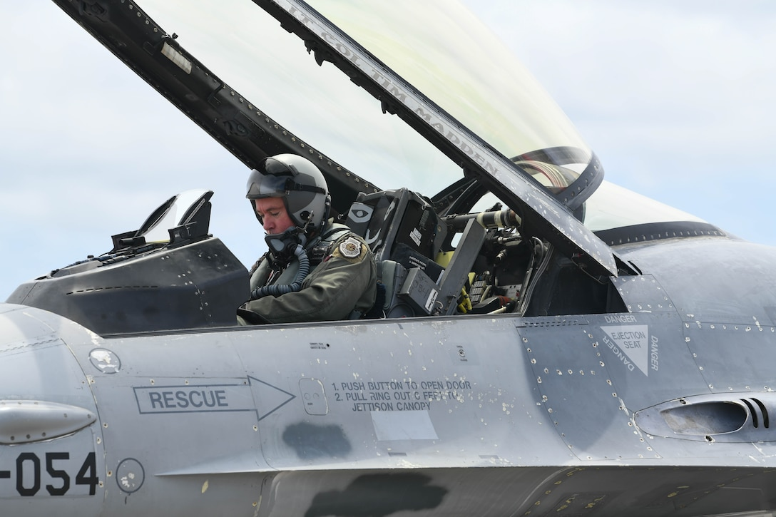U.S. Air Force Col. Nicholas Reed with the 53rd Weapons Evaluation Group, commander, prepares to take flight in a QF-16 from the 82nd Aerial Targets Squadron at Tyndall Air Force Base, Florida, Aug. 21, 2020. Pilots flew out several aircraft from the 325th Fighter Wing's airfield after evacuation orders had been called due to rising concerns over severe weather conditions. (U.S. Air Force photo by Airman Anabel Del Valle)