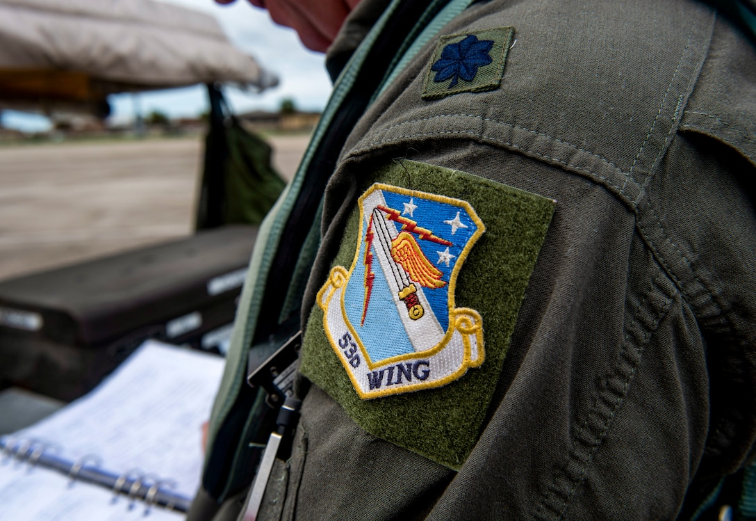 Pictured is a unit patch on the flight suit of U.S. Air Force Lt. Col. Travis Winslow with the  82nd Aerial Targets Squadron, commander, at Tyndall Air Force Base, Florida, Aug. 21, 2020. Reed, along with multiple pilots, rushed to evacuate QF-16 aircraft from the 325th Fighter Wing's airfield to Shaw Air Force Base, South Carolina, in preparation for storm conditions. (U.S. Air Force photo by Staff Sgt. Magen M. Reeves)