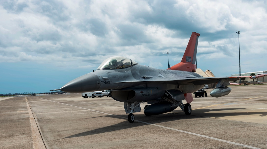 U.S. Air Force Lt. Col. Travis Winslow, 82nd Aerial Targets Squadron, commander, taxies a QF-16 aircraft for takeoff at Tyndall Air Force Base, Florida, Aug. 21, 2020. Wilson piloted the aircraft to Shaw Air Force Base, South Carolina, as part of an airfield evacuation in preparation for severe weather conditions. (U.S. Air Force photo by Staff Sgt. Magen M. Reeves)