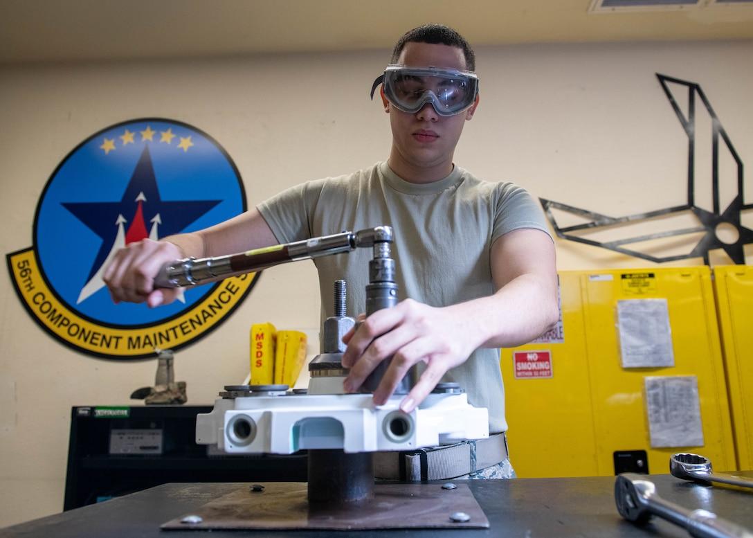 Hydraulics Airman assembles F-16 brake