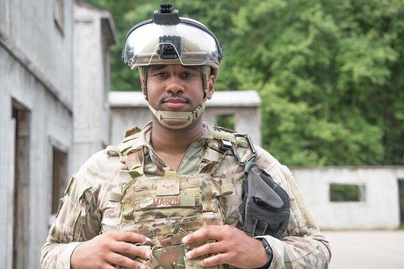 An Airman wears his helmet and flack vest