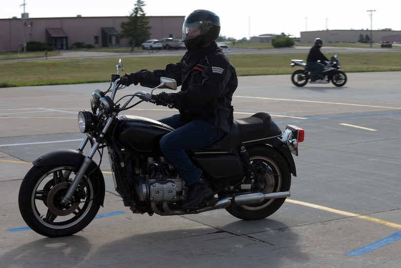 Airmen Assigned to the 28th Bomb Wing performs motorcycle maneuver.