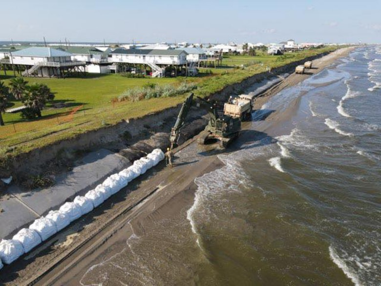Members of the Louisiana National Guard's 843rd Engineer Company help local and state agencies reinforce the exposed burrito levee in Grand Isle before Tropical Storm Marco and Hurricane Laura. The hurricane was scheduled to make landfall Aug. 26-27, 2020.