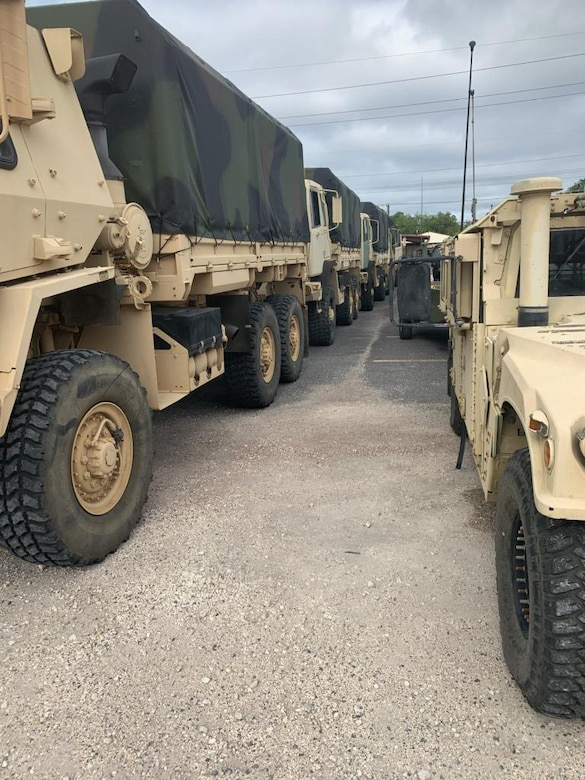 Louisiana National Guard members stage key equipment and Guard members in Lake Charles Aug. 25, 2020, to respond after Hurricane Laura makes landfall in southwest Louisiana.