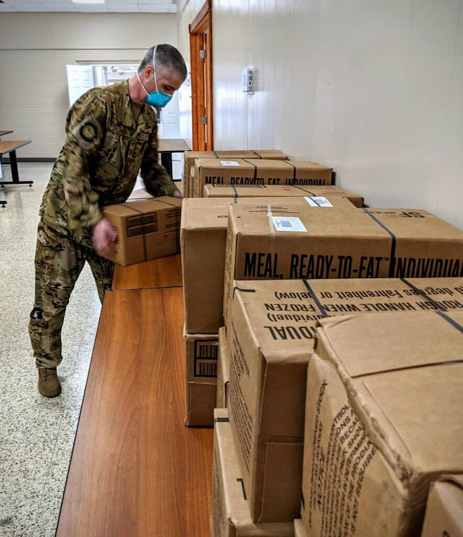 Members of the Texas National Guard help prepare supplies, including military rations, or meals ready to eat, in case they are needed in response to the expected arrival of Hurricane Laura Aug. 26-27, 2020.