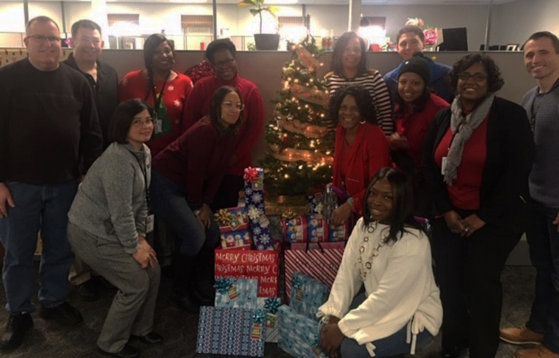 Sean Shockley poses with team members and Angel Tree gifts they collected in 2019