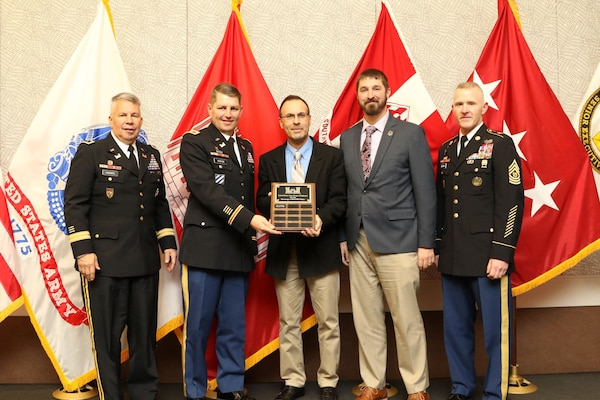Daniel Curado (center), small business program chief, U.S. Army Corps of Engineers, Omaha District, and Matt Hibbert, small business program specialist, receive a HQ USACE award from Col. John Hudson, former district commander, for dollars obligated to the service disabled veteran owned small business program in 2019.  Lt. Gen. Todd Semonite, USACE Commander (left) and former USACE Command Sgt. Maj. Bradley Houston were in attendance. (Courtesy photo)