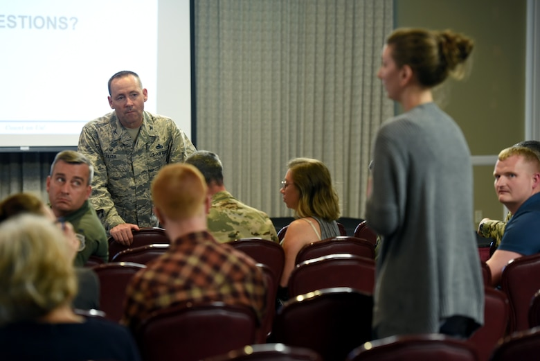 Col. Paul Filcek, 72nd Air Base Wing commander, talks to a housing resident at Tinker Air Force Base, Oklahoma,