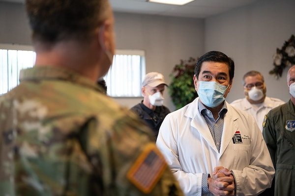 Dr. Martin Bautista, a physician at the Memorial Hospital of Texas County in Guymon, Oklahoma, welcomes members of the Oklahoma Army and Air National Guard, Centers for Disease Control and Prevention, the Oklahoma State Department of Health, Oklahoma State University laboratories, and the Federal Emergency Management Agency, during a visit to the hospital, May 15, 2020. As of May 19, 2020, Guymon had 650 confirmed cases of COVID-19, making it second in the total number of cases in Oklahoma. Oklahoma City, which has the highest number of COVID-19 cases, has the largest population of any city in Oklahoma, Guymon is 40th. Beginning at the Memorial Hospital of Texas County, which has been seeing an average of three to four COVID-19 patients a day, and then moving on to the Texas County Health Department and the Seaboard Foods pork processing plant, the group focused on creating solutions to issues such as facility layouts, and supply, resources, and staffing shortages. (Oklahoma Air National Guard photo by Tech. Sgt. Kasey M. Phipps)
