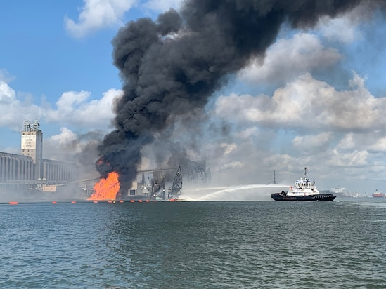 Coast Guard crews respond to a dredge on fire in the Port of Corpus Christi Ship Channel, Aug. 21, 2020. A Sector/Air Station Corpus Christi MH-65 Dolphin helicopter crew was launched to the scene, hoisted two injured crewmembers and transferred them to Corpus Christi Medical Center - Bay Area.