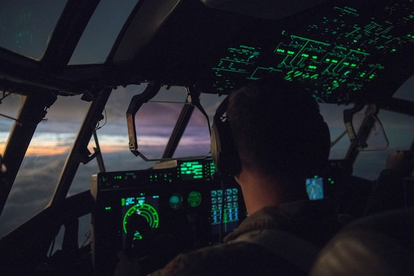 Maj. David Gentile, WC-130J pilot for the 53rd Weather Reconnaissance Squadron, flies towards the sunset after a pass through Hurricane Laura from Charleston International Airport, S.C. Aug. 25, 2020. The 53rd WRS operates out of Keesler Air Force Base, Miss., and plays an important role in the forecasting of tropical systems by flying directly into storms and collecting atmospheric data satellites cannot reach, improving the area of impact forecast by up to 25 percent. (U.S. Air Force photo by Senior Airman Kristen Pittman)