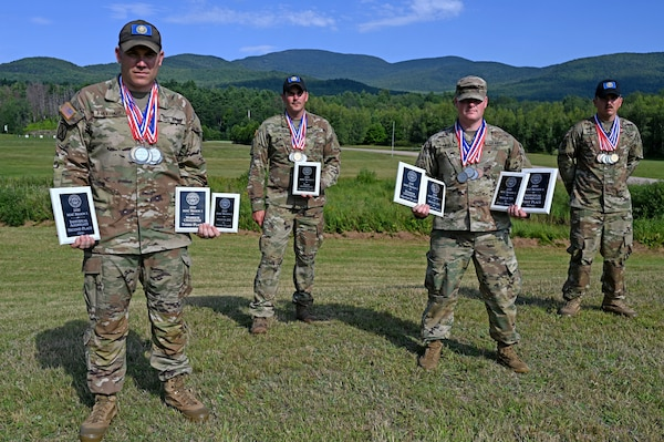 From left, Maj. Brooks Hayward, Staff Sgt. Joseph Wyner, Capt. Patrick Randall and Staff Sgt. David Musso show off their medals and plaques won at the 2020 Military Advisory Council Region 1 (MAC 1) shooting match on Aug. 23, 2020, at Camp Ethan Allen Training Site in Jericho, Vt.