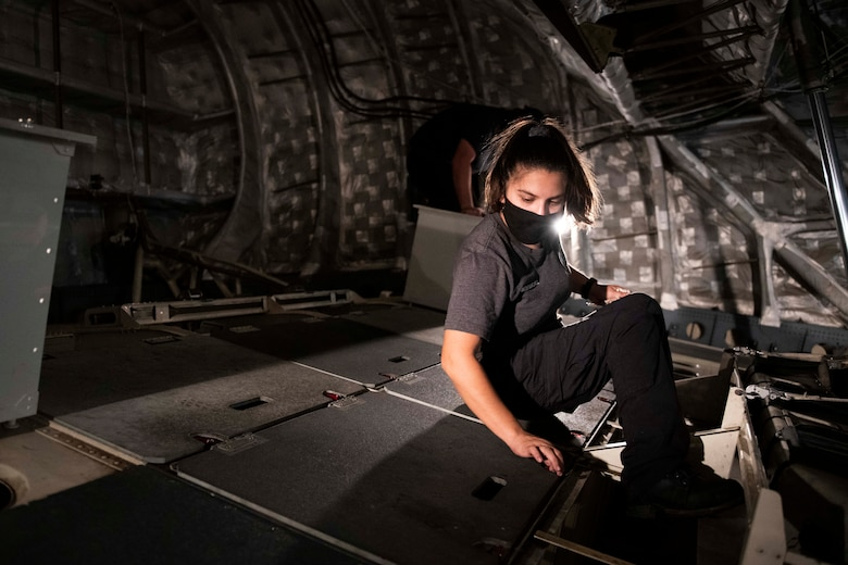 Aircraft attendants clean the inside of a C-17 Globemaster III.