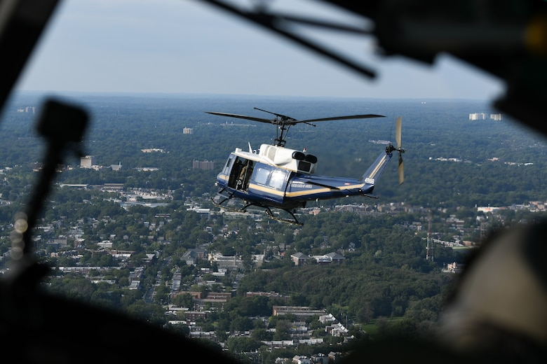 """A UH-1N """"Huey"""" from the 1st Helicopter Squadron flies over the District of Columbia, Aug. 26, 2020."""