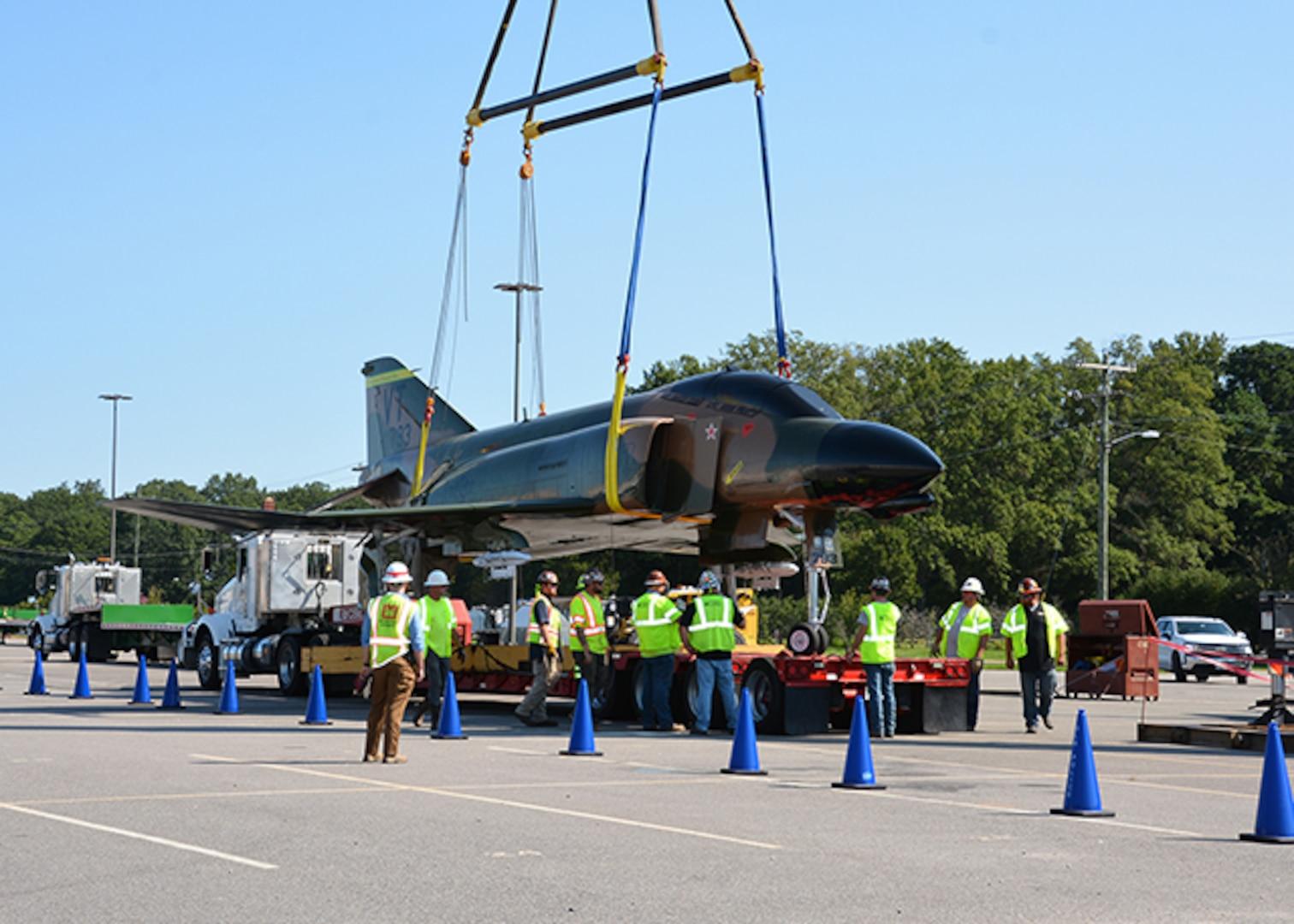 F-4 Phantom II is loaded on a transport