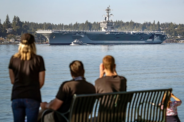 The USS Carl Vinson (CVN 70) makes its way past Point Herron Aug. 23, 2020 after departing Puget Sound Naval Shipyard & Intermediate Maintenance Facility in Bremerton, Washington. PSNS & IMF completed a docking planned incremental availability on Vinson Aug. 27, 2020, as the aircraft carrier completed sea trials enroute to San Diego, where it was homeported prior to its arrival at Naval Base Kitsap-Bremerton, Jan. 20, 2019.(PSNS & IMF photo by Scott Hansen)
